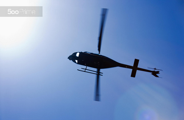 Black-Helicopter-Flying-Overhead