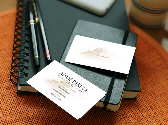 Business Cards on Table with Books Mockup